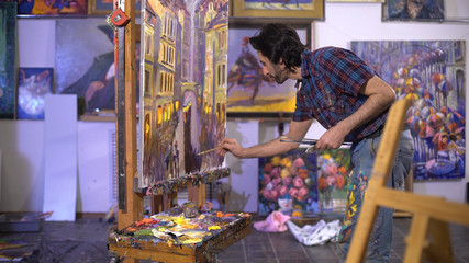 senior man painting on a canvas