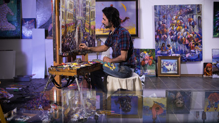 creation. senior man painting on a canvas