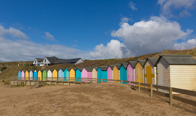 Bude North Cornwall England uk colourful pastel beach huts on the beach