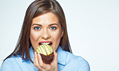 Young woman biting french cookie. Close up face portrait