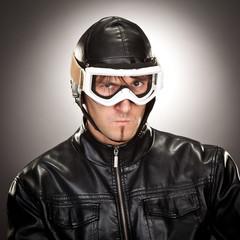 crazy vintage biker portrait on grey background