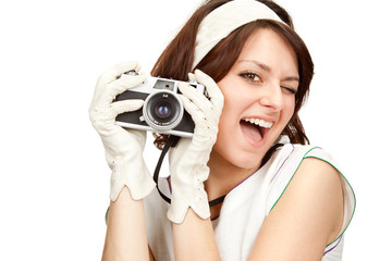 beautiful vintage girl take photograph with old camera isolated on white
