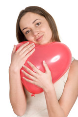 beautiful girl holding a red balloon