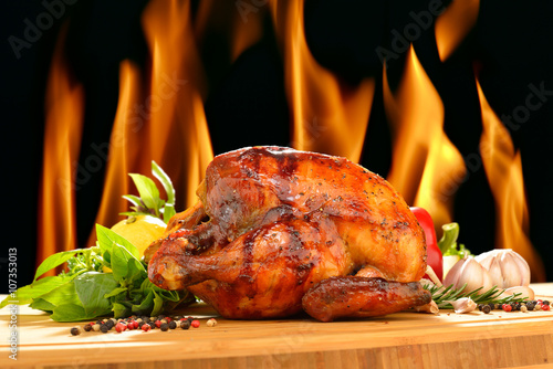 Fototapete Roast chicken and various vegetables on a chopping wood