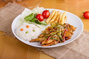 original fajita sizzling smoking Chicken breast with vegetables and sauce decorated with basil leaves