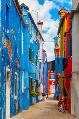 Street with colorful houses on the famous island Burano, Venice, Italy