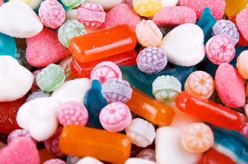 Closeup variation of colorful hard candy lying mixed as seen from above