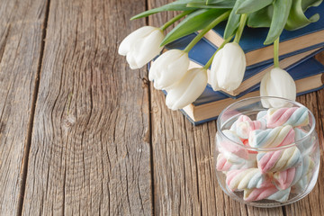 Books and flowers on wood table