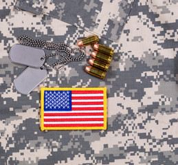 USA flag patch, ID tags, bullets on military uniform