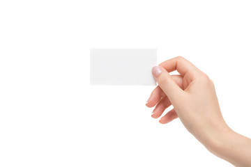 Isolated female hand holds white card on a white background.
