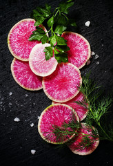 Food background: round slices of watermelon pink radish, dill, p