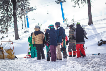 a crowd of young people on a snowy mountain