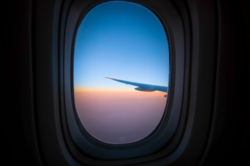 Airplane window sunrise background