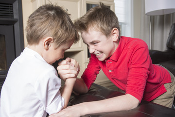 brothers compete in arm wrestling