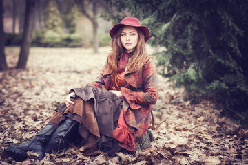 The beauty girl in ancient clothes of the Victorian era and a gracefu