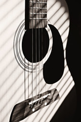 Classical guitar. Detail, selective focus. Shallow depth of field. Music, learning how to play the guitar and abstract concept