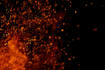 In de dag Vuur fire flames with sparks on a black background