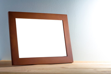 wooden photo frame on wooden table over grunge background, Still life style