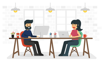 Man and woman working in coworking space.