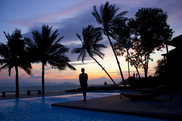 women stand by pool at Payarm Island, in Thailand, waiting for sunrise