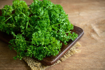 Bunch of parsley on a rustic wooden table