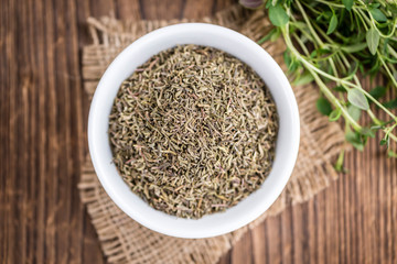 Dried Thyme on wooden background