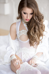 The girl with beautiful hair in a white lingerie