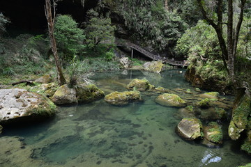 Tropical plants, sandy desert, waterfalls, craters and caves make a tourist attraction .