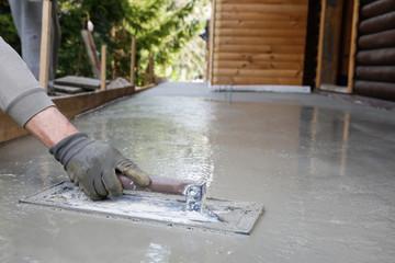 Mason leveling and screeding concrete floor base
