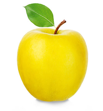 Ripe yellow apple isolated on a white background.