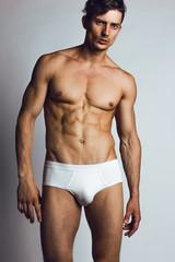 Male swimwear & underwear concept. Handsome muscular male model