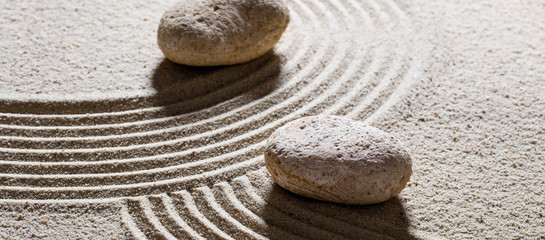 Photo sur Plexiglas Zen pierres a sable zen sand still-life - stones set across sinuous waves for concept of different directions or change with inner peace
