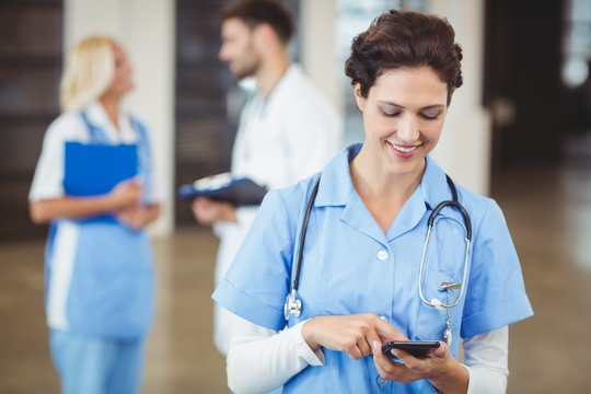 Nurse using on mobile phone