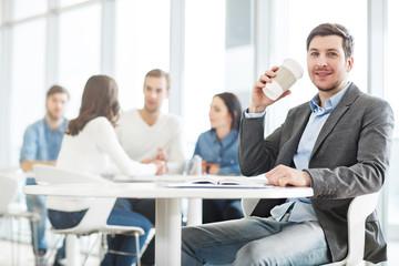 Positive man drinking coffee.
