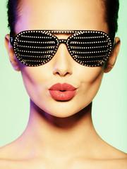 Fashion portrait of  woman wearing black sunglasses with diamon