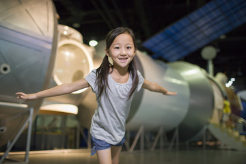 Little girl in science and technology museum