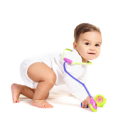 Portrait of a baby with a stethoscope on a white background