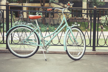 blue vintage city bicycle, concept for activity and healthy lifestyle