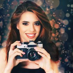 Fashion girl make a photo selfie at vintage camera.