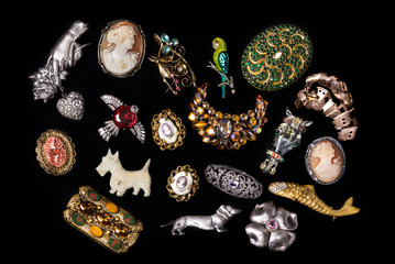 Antique and vintage jewelry collection isolated on a black background
