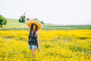 beautiful girl in a field of yellow flowers