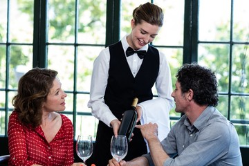 Couple selecting a bottle of wine