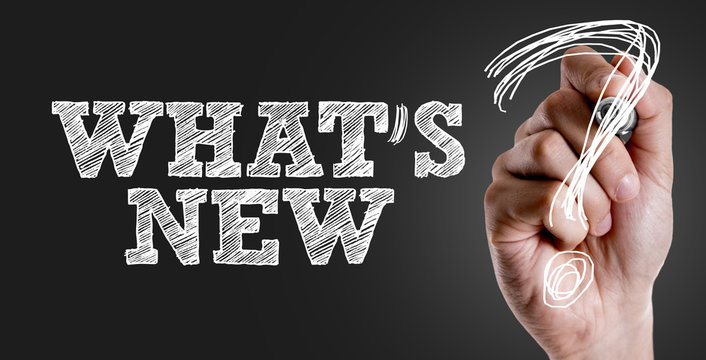 Hand writing the text: Whats New?