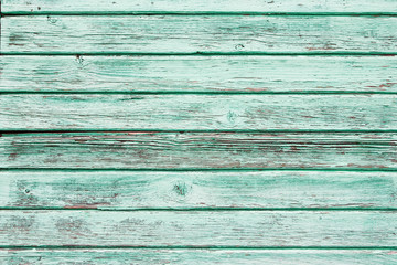 Green peeling paint wooden background.