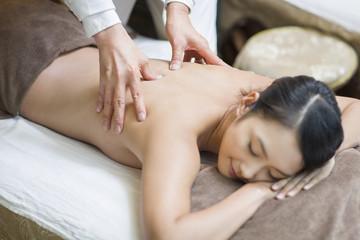 Young woman receiving shiatsu massage