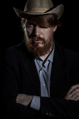 The bearded man on a dark background