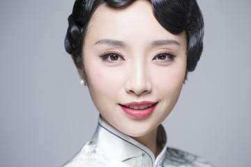 Headshot of young beautiful woman in traditional cheongsam