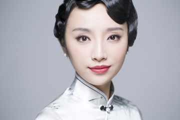 Headshot of young beautiful woman in traditional cheongsam