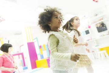 Little girls in the kindergarten