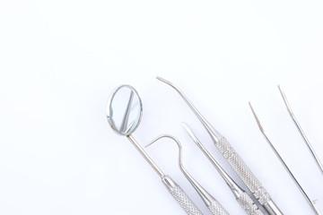 Dental tools on white background
